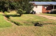 NEMiss.News Drainage ditches surround home
