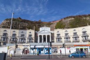 Seaside Buildings Against Cliff