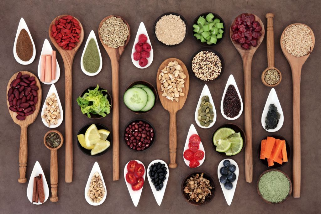 Healthy Foods in Spoons and Bowls