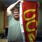 Jason Percival holding up the computer repair flag