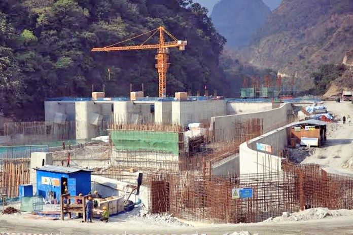 Workers engaged in the construction of 50 MW Marshyangdi Hydro Project dam at Bhulbhule in eastern Lamjung on Tuesday, November 03, 2015. Photo: Ramji Rana
