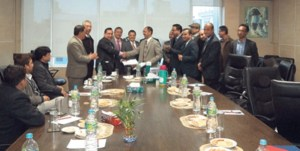 Everest Bank CEO AK Ahluwalia and BPC CEO Uttar Kumar Shrestha signing the agreement