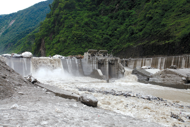 THRICE HIT: The Bhote Kosi hydropower dam last month after it was damaged by a flash flood caused by a landslide dam that burst in Tibet .