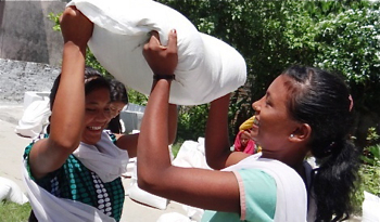 Tirthi with flood relief supplies