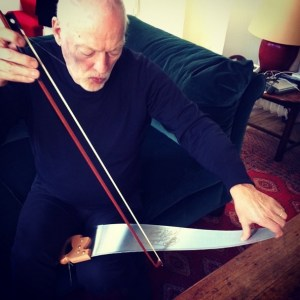 David Gilmour playing a saw with a bow