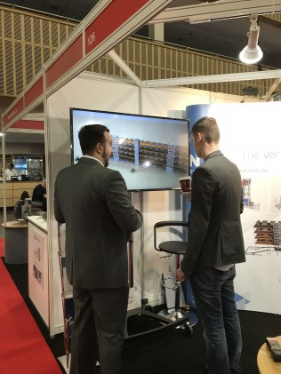 Visitors discuss the 3D visualisation of our Pick Floor Solution