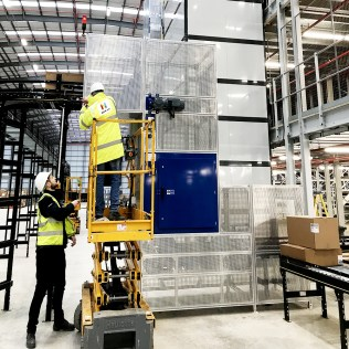 Senior Project Engineer Scott Amber and Engineering Manger Colin Watkins Running Tests on Boxlifter during the installation of a Fully Integrated NERAK System