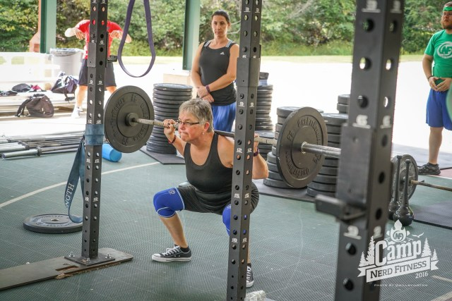 Joni doing squats at Camp Nerd Fitness, a great time for all involved.