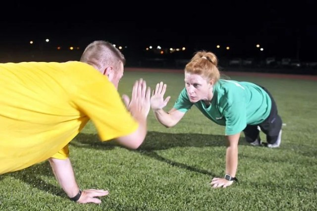 A personal trainer high-fiving a client.