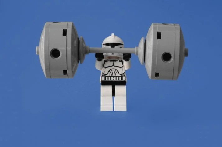 This stromstrooper is lifting weights to grow muscle and strength.