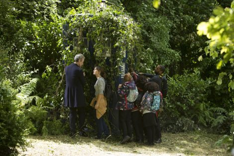 The Doctor and crew attempt to free the TARDIS of some overgrown foliage. [BBC]