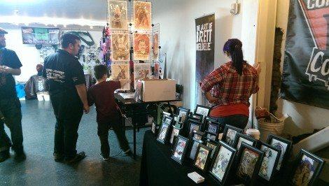 Casey checks out Brett Weldele's booth