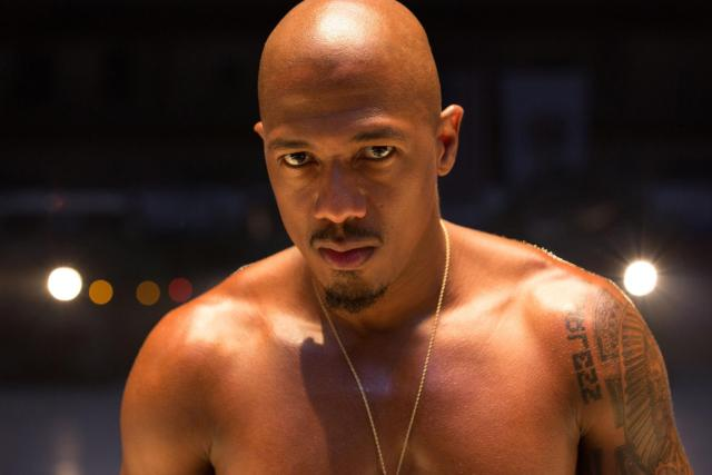 """This photo provided by Roadside Attractions and Amazon Studios shows Nick Cannon as Chi-Raq in Spike Lee's film, """"Chi-Raq."""" The movie opens in U.S. theaters on Dec. 4, 2015. (Parrish Lewis/Roadside Attractions/Amazon Studios via AP)"""