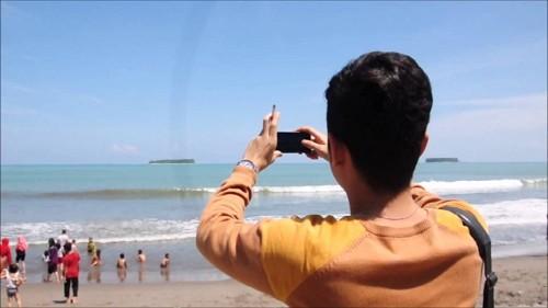 ilustrasi liburan di pantai