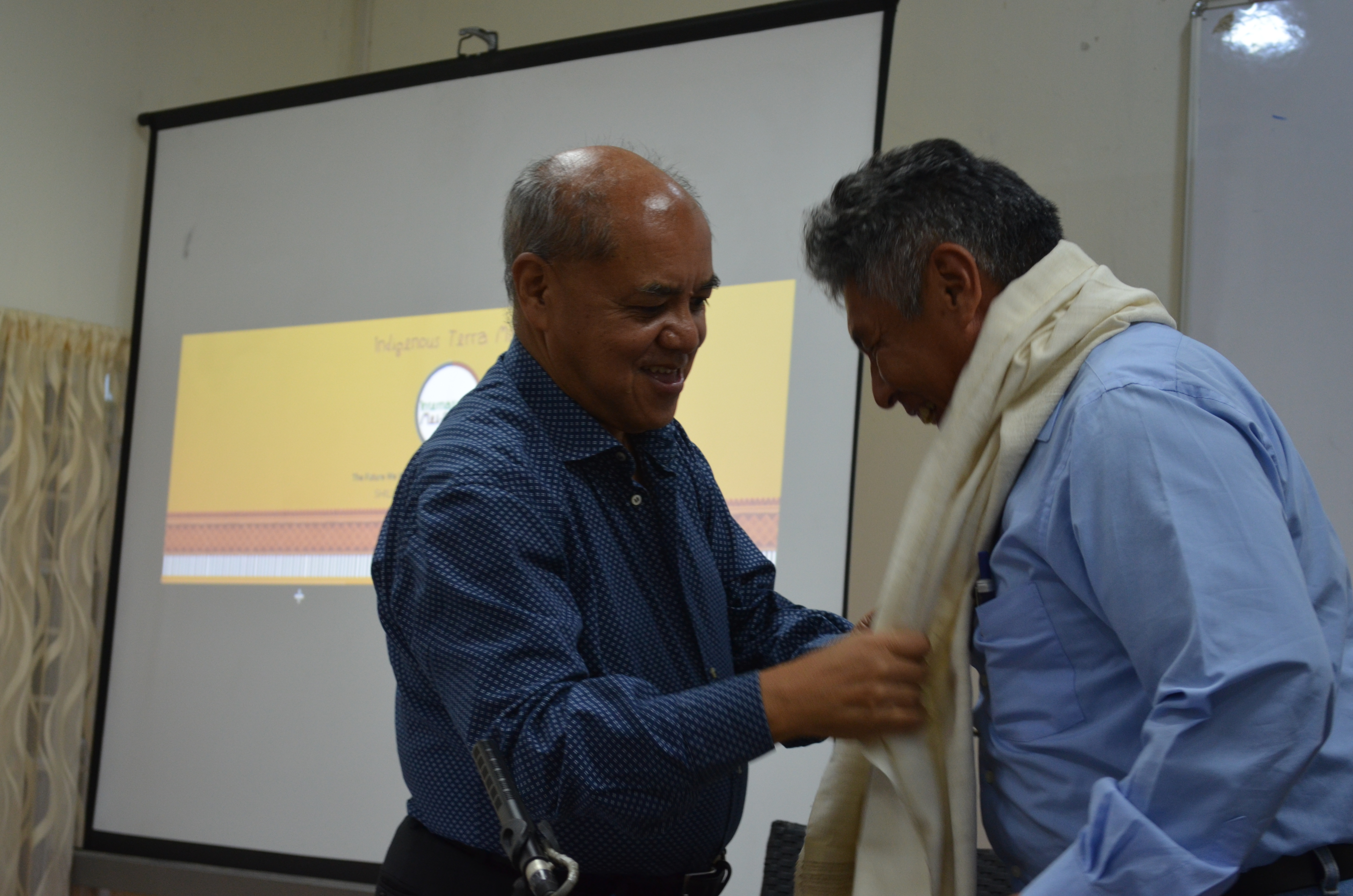 Shri Phrang Roy, Chairman NESFAS, honours and thanks Dr.Francisco Rosado may with a Ryndia Shawl from village community of  Rhiboi district.