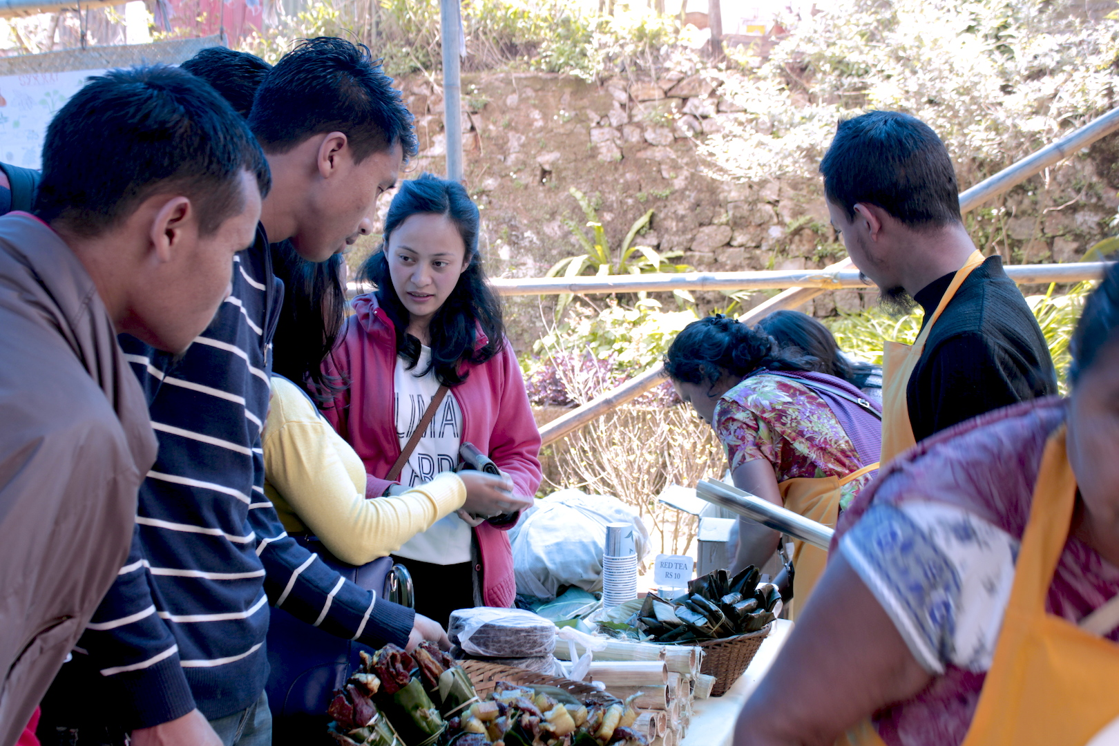 Students approach the Mei-Ramew cafe stall