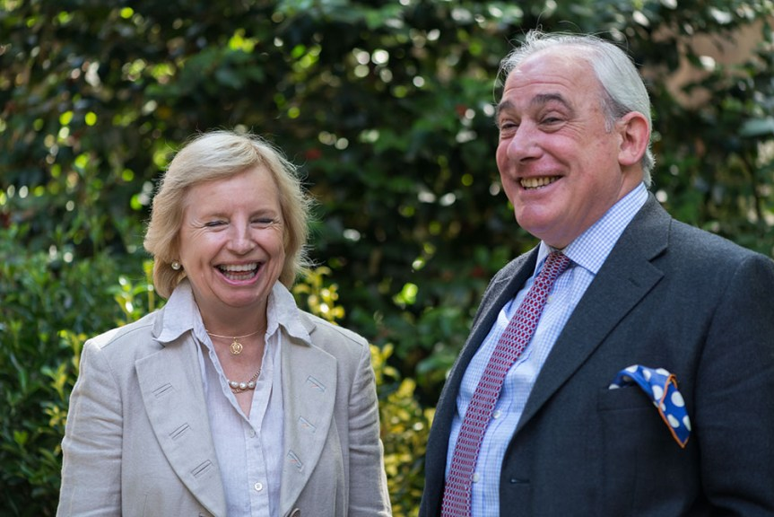 Helen Esmonde, Master, and William Alden, Clerk, share a joke in the garden at the Stationers Hall.