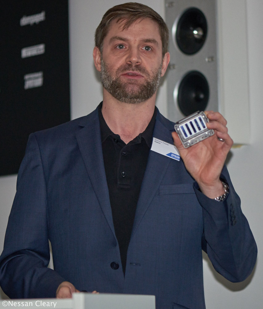 Dominic Fowler, Epson European Product manager for large format, showing off a PrecisionCore printhead.