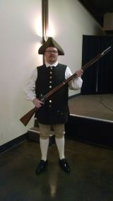 Lincoln Chapter President Shawn Stoner in Minute Man uniform with replica brown bess