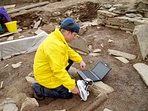 Professor Scott Pike at work on the deposits in Structure Ten. (ORCA)