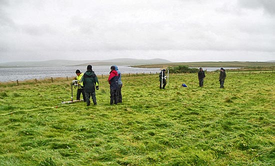 The geophysics team ignore the weather and battle on.