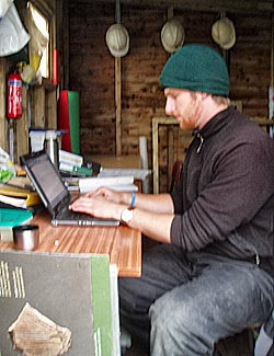 Michael escapes the rain to the relative dryness of the supervisor hut to write the diary.