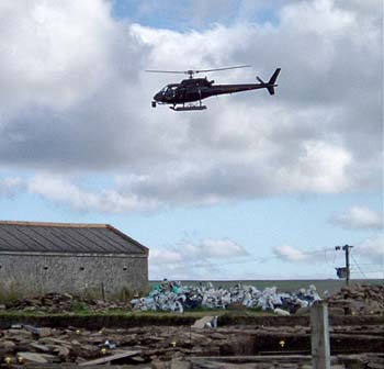 The BBC helicopter hovers low over the site.