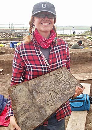 Joanne with the decorated slab she found yesterday.