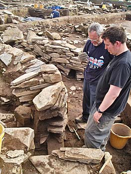Stewart and Chris contemplate the next move for the removal of the blockiing in the south entrance to Structure One.