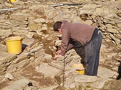 Stewart starts to remove the blocking in the southern entrance to Structure One that relates to its later phase of use.