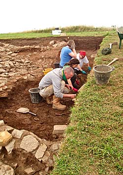 UHI students under the supervision of Keir Strickland investigate the makeup of the mound in Trench T.