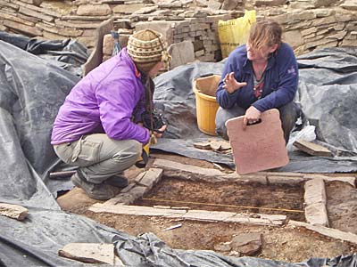 Zoe and Jo discuss the sampling of one of the many hearths in Structure Eight.