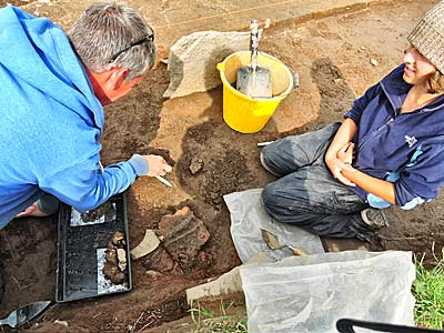 Laura, the pot magnet, is assisted by Jim in uncovering her latest mega-sherd of decorated pot just outside Structure Twelve.