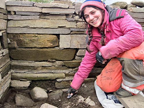 Andy discovers a small hammerstone from a little 'alcove' in Structure One.