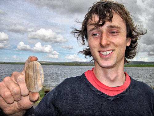 Callum and his polished 'humbug' stone from Structure One.