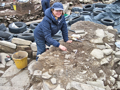 Jo slowly refines another part of the massive animal bone spread, this time at the rear of Structure Ten.