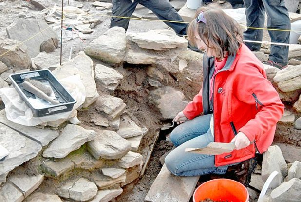 Antonia carefully recording the stone in situ prior to its removal yesterday.