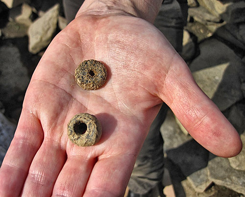 Jay's two beads, from under the north-east buttress of Structure Ten.