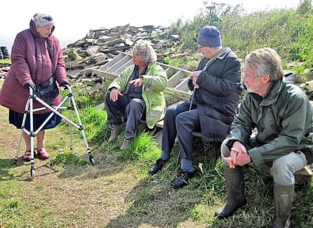 Mark Edmonds discusses a point with Colin and Jane Renfrew and Nick Card.