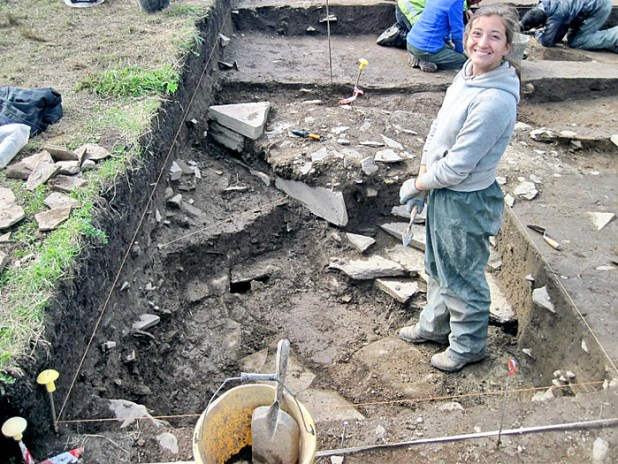 Tori's smile says it all, with her discovery of the drain parallel to the wall in Trench T.