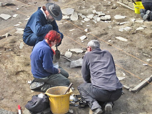 Jo McKenzie, our micro morphologist, discusses sampling, next to one of the Structure Twelve hearths, with Ray and Chris.