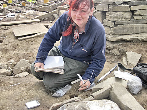 Micromorphologist Jo burrows into the floors of Structure Eight to retrieve samples.