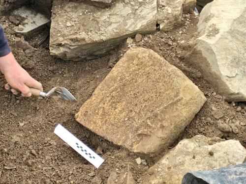 The large, peck-dressed, yellow-sandstone block revealed by Robert.
