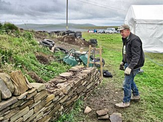 Stonemason Kevin Critchlow shows off his skills in drystane walling - nothing much has changed in 5,000 years.