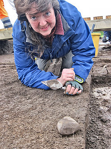 Lorraine with another fine discovery from Trench X - a 'pillow' stone.
