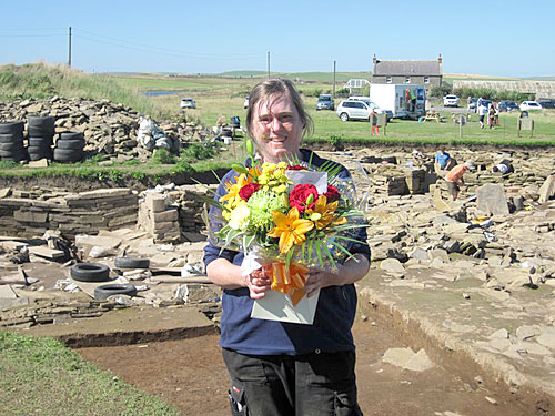 Romance isn't dead. Claire, with her wedding-anniversary bouquet sent north by Mike.