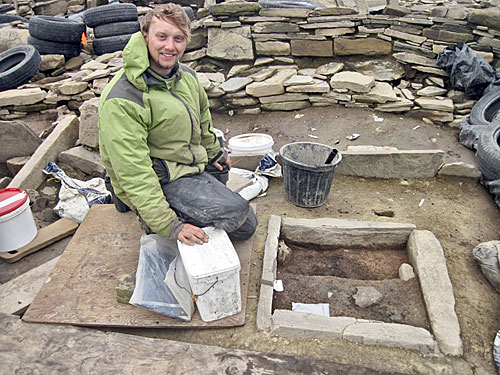 Sam Harris hard at work sampling one of the hearths in Structure Eight.
