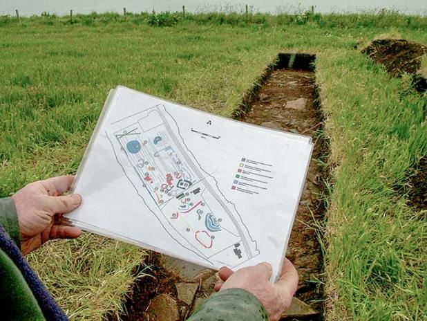 June 16, 2004 — Excavation director, Nick Card, examines the geophysics scan results during the initial excavations on the Ness of Brodgar. (Sigurd Towrie)