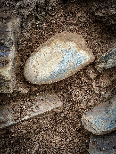 The stone axehead from the bottom of Trench J ready to lift...