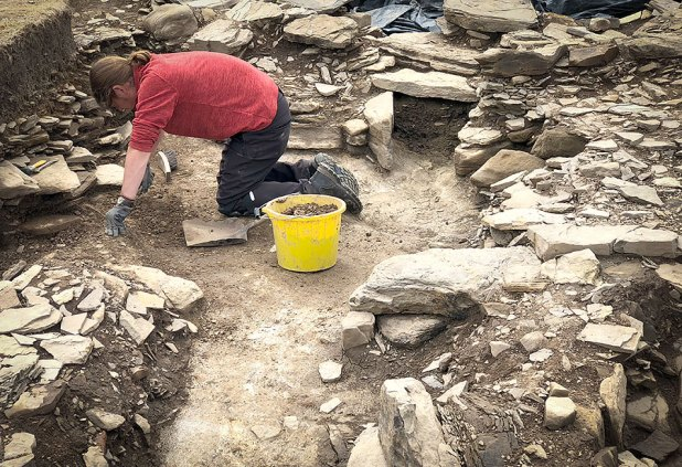 Surrounded by archaeology. Doug at work in Trench J.